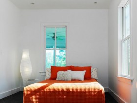White bedroom with colorful bed