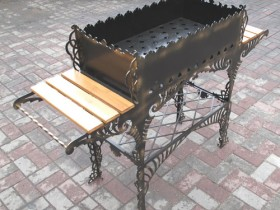Wrought iron grill with wood shelves