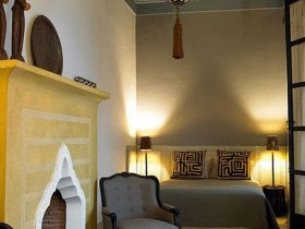 The interior of living room with fireplace, Moroccan style