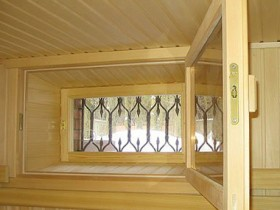 Windows made of wood for sauna
