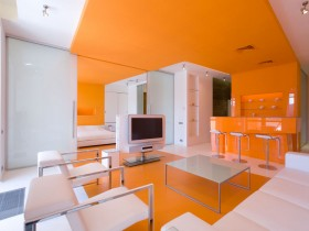 Orange living room with white sofa