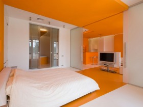 Interior design bright bedroom in orange color
