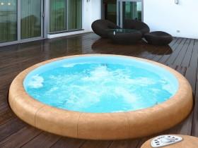 Прыгожы круглы басейн на тэрасе