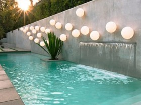 Outdoor pool with creative lighting