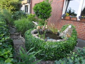 The front garden with an artificial pond