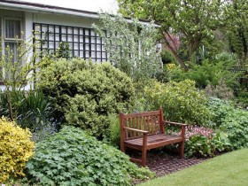 Front garden with wooden bench