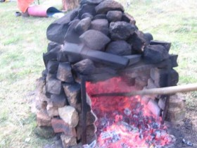 The heating of stones for a camp bath