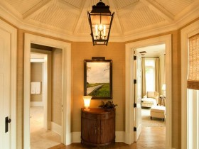 Spacious entrance hall with antique chandelier and chest of drawers