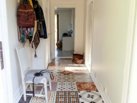 White hallway with colored tile floors and racking