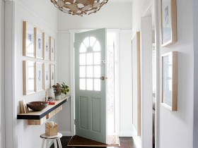 White entrance hall with beautiful chandelier and shelf