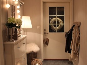 Small white hallway with mirror and nightstand