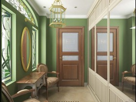 Green and white entrance hall with large mirror