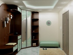 Modern hallway with corner Cabinet and tiered ceiling