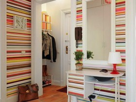 White hallway with colorful Wallpaper