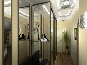 Hallway in the apartment with a large mirrored wardrobe