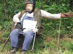 Sitting Scarecrow in the form of a grandfather