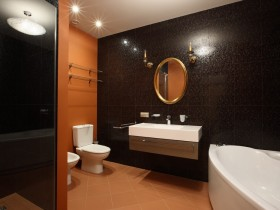 Bathroom in black and orange shades