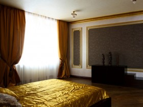 Bedroom decor in gold and dark colors