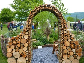 Arch in the garden from logs of different diameters