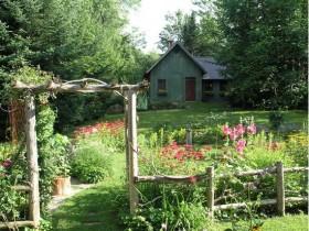 Wooden garden arch in a rural garden
