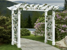 Stylish garden arch made of painted wood