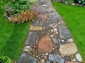 Garden path of rocks with a mosaic