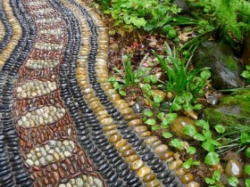 Wavy garden path of colored pebbles