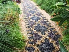 unusual garden path of colored pebbles
