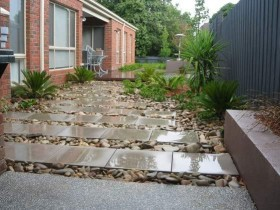 Garden path ceramic tile and large pebbles
