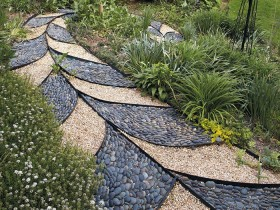 Creative garden path made of pebbles and decorative gravel