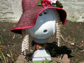 The idea of a homemade figurine in the garden