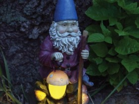 Garden lamp in the form of an elf