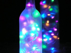The idea of garden lamps: garlands in the bottle