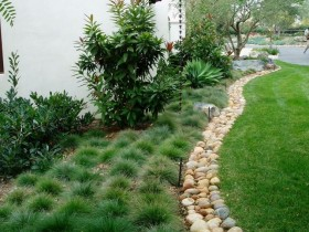 Border for flower beds with natural stone