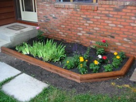 Wooden border for flower beds
