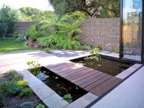 Wooden bridge in a modern garden