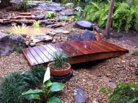 Wooden garden bridge, varnished