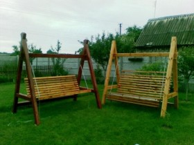 Wooden garden swing in the country
