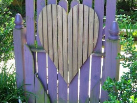 A wooden gate in the shape of a heart