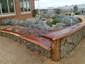 Garden bench in the role of a border for flower beds