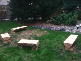Garden benches from a tree trunk