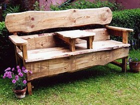 Wooden bench in the garden of their own making