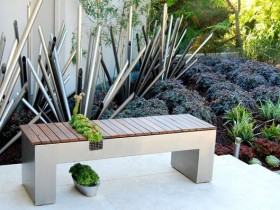 Stylish bench with vegetation