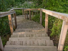 Wooden garden stairs with their hands