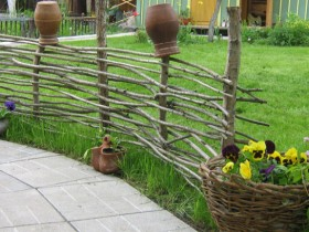 Decorative fence in a rural garden
