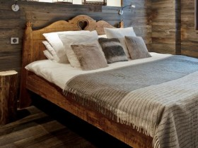 Bedroom interior with wooden finish, the Chalet-style