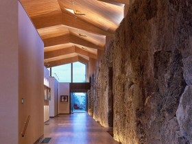 The corridor in the cottage with stone wall, the Chalet-style