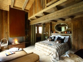 Master bedroom with fireplace in a wooden finish