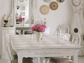 White dining room with antique furniture