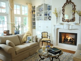 Living room with fireplace in the style of shabby chic